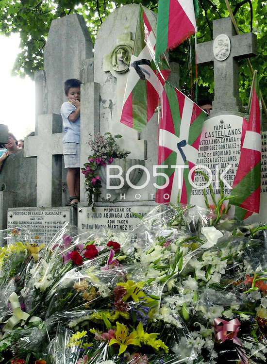 Family and friends attend the burial of ETA member Olaia Kastresana on July 30, 2001, in the cemetery of Donostia-San Sebastian, Basque Country. (Ander Gillenea / Bostok Photo)