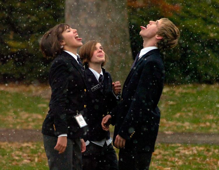 House pages from left, Elizabeth Bryant, 16, of North Carolina, Stasie Smith, 16, of California, and Andrew Breest, 16, of Georgia, try to catch snowflakes during their lunch break, on the West Front, Monday.