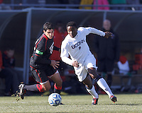 University of Connecticut midfielder George Fochive (9) starts counter attack as Northeastern University midfielder Andre Ciliotta (10) closes..NCAA Tournament. University of Connecticut (white) defeated Northeastern University (black), 1-0, at Morrone Stadium at University of Connecticut on November 18, 2012.