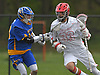Sean Lulley #33 of Half Hollow Hills East, right, gets pressured by Mike Alexander #10 of West Islip during a Suffolk County varsity boys lacrosse game against West Islip at Half Hollow Hills High School East on Tuesday, May 9, 2017. Lulley tallied a goal and four assists as Hills East rallied from an early 6-2 deficit to win 14-10.