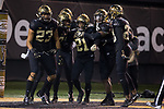 Essang Bassey (21) of the Wake Forest Demon Deacons is congratulated by teammates Ja'Sir Taylor (24), Jaboree Williams (6),, Coby Davis (20), and Justin Strnad (23) after intercepting a pass late in the fourth quarter of the game against the North Carolina State Wolfpack at BB&T Field on November 18, 2017 in Winston-Salem, North Carolina.  The Demon Deacons defeated the Wolfpack 30-24.  (Brian Westerholt/Sports On Film)
