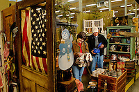 Shoppers Cindy Rescigno and Larry Hargrave from Winston-Salem, North Carolina looks through the thousands of unique items available for purchase at the Depot at Gibson Mill. The Depot at Gibson Mill, an antique and designer mall that was once a mill, located in Concord, N.C. With 85,000 square feet and 460 booths, we have quickly become the largest antique and designer mall in the South. Once a part of the old Cannon Mills, the charm of the 20 foot ceilings, wide wooden floors and exposed brick remains. Photo is part of a photographic series of images featuring Concord, NC, by Charlotte-based photographer Patrick Schneider..