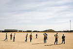 Soldiers from the 110th MP Co. play a game of touch football on Fort Carson, Friday, Feb. 20, 2009...Major General Mark Graham and his wife, Carol, talk about the deaths of their two sons in their Fort Carson home in Colorado Springs, Colo.  Their son, Second Lt. Jeff Graham was killed by a roadside bomb in Iraq just months after their other son, ROTC Cadet Kevin Graham, committed suicide in his apartment.  Since Kevin's suicide, the Grahams have been outspoken advocates for suicide prevention.