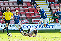 Pars' Finn Graham goes in late on Stranraer's Willie Gibson.