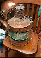 BNPS.co.uk (01202 558833)<br /> Pic: PhilYeomans/BNPS<br /> <br /> Ray Ives Locker<br /> <br /> Hooded wartime starboard light from a ammunition barge blown up by a German bomber in 1942.<br /> <br /> Old man of the sea Ray Ives has opened his very own Davy Jones' locker of hundreds of nautical treasures he has salvaged from the seabed.<br /> <br /> Ray(77) has spent 40 years amassing a huge trove of historical artefacts that he has found during thousands of deep sea dives off the British coast.<br /> <br /> Ray's watery Aladdins cave includes canon balls, muskets, swords and even the bell from an ocean liner sunk by a German U-boat in the First World War.<br /> <br /> For years Ray had stuffed his collection into a tiny shed in the back garden of his home in Plymouth, Devon.<br /> <br /> But now the fascinating archive has now gone on display to the public in a ramshackle museum made from shipping containers.