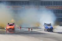 Apr. 28, 2013; Baytown, TX, USA: NHRA funny car driver Robert Hight (right) alongside Johnny Gray during the Spring Nationals at Royal Purple Raceway. Mandatory Credit: Mark J. Rebilas-