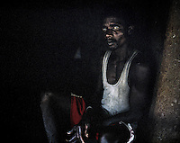 28 year old Raju Haibro outside his hut in Balighato village in Kalinganagar. On 2 January 2006, Raju was shot in the shoulder when police in Kalinganagar opened fire on a group of tribals protesting against Tata's constructon of a steel plant on their land without having paid them adequate compensation. The killing of 12 villagers shocked the whole nation and all but paralysed the state government over the land issue. Armed with bows and arrows, the villagers keep a tight vigil at the entrance of their village to stop company officials or police entering their land.