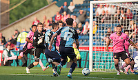 Danny Rowe of Wycombe Wanderers scores the first League goal of his career to make it 3-2 to Northampton  during the Sky Bet League 2 match between Wycombe Wanderers and Northampton Town at Adams Park, High Wycombe, England on 3 October 2015. Photo by Andy Rowland.
