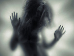 Beautiful young woman blurred silhouette behind glass Image © MaximImages, License at https://www.maximimages.com