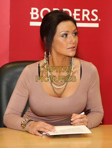 JENNI FARLEY (JWoww).'The Rules According to JWoww' book signing at Borders Columbus Circle, New York, USA, 9th February 2011..half length sitting dress long sleeve  earrings dangly chains necklace silver beige brown .CAP/LNC/TOM.©LNC/Capital Pictures.