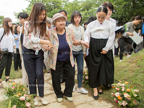 Kil Won-ok, Aug 29, 2016 : Kil Won-ok (2nd L, front), who said that she was forced to become a sex slave by Japanese army during World War II, attends an opening ceremony for a park commemorating the victims of Japan's sexual enslavement during Japan's occupation of the Korean Peninsula (1910-45), on Mount Nam in Seoul, South Korea. The Seoul Metropolitan Government and a committee which is charge of building the memorial park held the ceremony on Monday, which  marks the 106th anniversary of the colonization. The place of the memorial park is the former residence of Japan's colonial-era resident-general, where the annexation treaty between Korea and Japan was signed on August 22, 1910. The treaty went into effect one week later. (Photo by Lee Jae-Won/AFLO) (SOUTH KOREA)