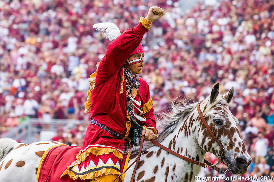 TALLAHASSEE, FLA 9/10/16-Florida State student Brendan Carter portrays the Seminole mascot Osceola and plants while riding Renegade prior to the 2016 home opener against Charleston Southern Saturday at Doak Campbell Stadium in Tallahassee. <br /> COLIN HACKLEY PHOTO