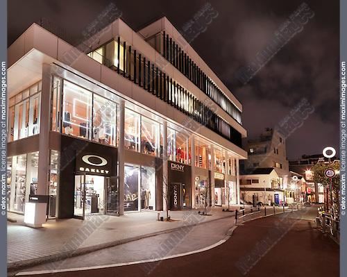 Oakley and DKNY clothing stores at night. Harajuku, Tokyo, Japan.