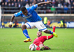 Aberdeen v St Johnstone....01.02.14   League Cup Semi-Final<br /> Nigel Hasselbaink skips a tackle from Shaleum Logan<br /> Picture by Graeme Hart.<br /> Copyright Perthshire Picture Agency<br /> Tel: 01738 623350  Mobile: 07990 594431