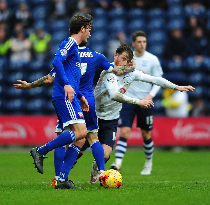 Preston North End's Joe Garner appears to be caught in the face by Brentford's Sam Saunders which leads to tempers on both sides boiling over<br /> <br /> Photographer Chris Vaughan/CameraSport<br /> <br /> Football - The Football League Sky Bet Championship - Preston North End v Brentford - Saturday 23rd January 2016 -  Deepdale - Preston<br /> <br /> &copy; CameraSport - 43 Linden Ave. Countesthorpe. Leicester. England. LE8 5PG - Tel: +44 (0) 116 277 4147 - admin@camerasport.com - www.camerasport.com