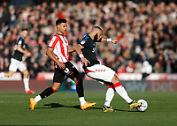 8th February 2020; Griffin Park, London, England; English Championship Football, Brentford FC versus Middlesbrough; Ollie Watkins of Brentford marking Harold Moukoudi of Middlesbrough  - Strictly Editorial Use Only. No use with unauthorized audio, video, data, fixture lists, club/league logos or 'live' services. Online in-match use limited to 120 images, no video emulation. No use in betting, games or single club/league/player publications
