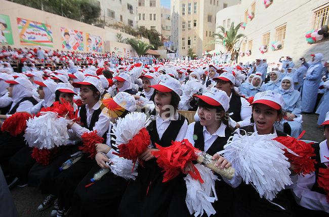 """Palestinian students celebrate after winning the Best School Competition """"challenge the Arab reading"""" of the more than 30 thousand schools in the Arab world, in the West Bank city of Nablus, on October 24, 2016. Photo by Nedal Eshtayah"""
