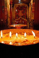 Yak butter lamp burns in ancient former mediatation chamber of Songtsen Gampo, 7th century king of Tibet, Ani Sanghkhung Nunnery, Lhasa, Tibet, China.