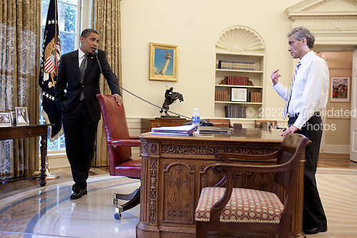 Washington, DC - June 25, 2009 -- United States President Barack Obama talks with Chief of Staff Rahm Emanuel during a phone call in the Oval Office, June 25, 2009. .Mandatory Credit: Pete Souza - White House via CNP