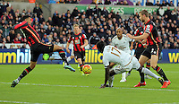 Eder of Swansea (17) gets up on his feet as his header is stopped by Sylvain Distin of Bournemouth (L) during the Barclays Premier League match between Swansea City and Bournemouth at the Liberty Stadium, Swansea on November 21 2015