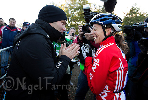 03 NOV 2012 - IPSWICH, GBR - Helen Wyman (GBR) (right) of Great Britain talks with the 1992 Junior Men's World Cyclo Cross Champion  Roger Hammond after she had won the Elite Women's European Cyclo-Cross Championships in Chantry Park, Ipswich, Suffolk, Great Britain (PHOTO (C) 2012 NIGEL FARROW)
