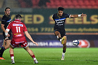 Anthony Watson of Bath Rugby puts boot to ball. European Rugby Champions Cup match, between the Scarlets and Bath Rugby on October 20, 2017 at Parc y Scarlets in Llanelli, Wales. Photo by: Patrick Khachfe / Onside Images