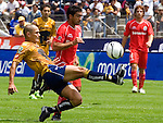 Mexico (27.08.2006) UNAM Pumas defender Dario Veron (L) fights for the ball with Toluca Diablos Rojos forward  Antonio Matias during their soccer match at the University Stadium in Mexico City, August, 27, 2006. UNAM Pumas tied 0-0 to Toluca.   © Photo by Javier Rodriguez