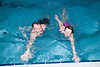 Two people swimming in the pool at their local leisure centre,