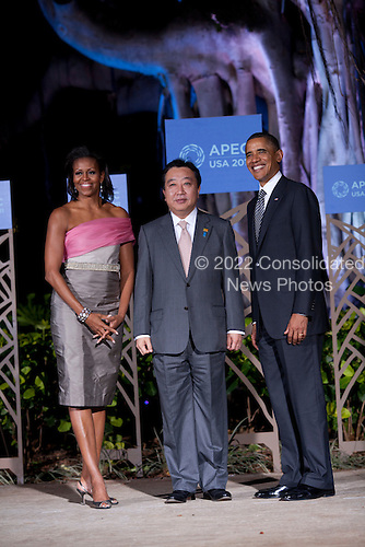United States President Barack Obama, right, and first lady Michelle Obama, left, pose for a portrait with Prime Minister Yoshihiko Noda of Japan (C) before the Asia-Pacific Economic Cooperation (APEC) summit dinner at the Hale Koa Hotel in Honolulu, Hawaii on Saturday, November 12, 2011..Credit: Kent Nishimura / Pool via CNP