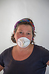 Middle aged woman wearing face mask doing DIY work indoors, England, UK