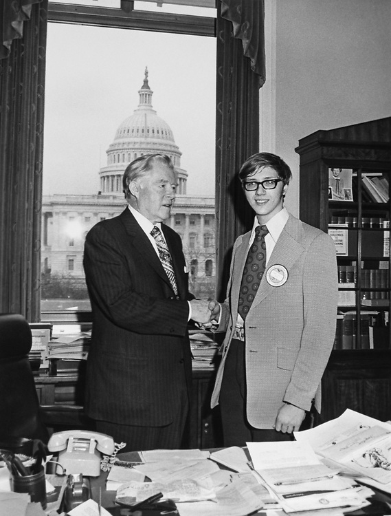 Rep. Ray Madden, D-Ind., shaking hands with the Presidential Scholar. (Photo by Dev O'Neill/CQ Roll Call)