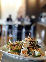 grilled and skewered scallops served with grilled romaine