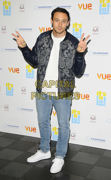 Jason Maza<br /> The &quot;It's A Lot&quot; UK film premiere, Vue West End cinema, Leicester Square, London, England.<br /> October 21st, 2013<br /> full length black jacket blue white paisley jeans denim hands arms v peace sign <br /> CAP/CAN<br /> &copy;Can Nguyen/Capital Pictures