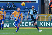 Mansfield Town's Jamie McGuire lifts the ball over the head of Wycombe Wanderers Paul Hayes during the Sky Bet League 2 match between Mansfield Town and Wycombe Wanderers at the One Call Stadium, Mansfield, England on 31 October 2015. Photo by Garry Griffiths.