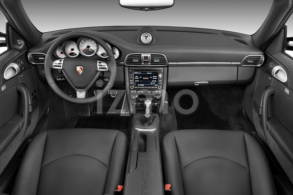 Straight dashboard view of a 2009 Porsche Carrera Turbo.