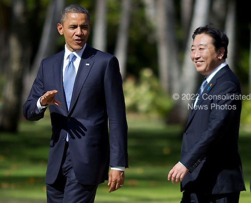 United States President Barack Obama, Prime Minister Yoshihiko Noda of Japan and world leaders walk to participate in the Asia-Pacific Economic Cooperation (APEC) family photo session at the J.W. Marriott Hotel in Honolulu, Hawaii on Sunday, November 13, 2011..Credit: Kent Nishimura / Pool via CNP