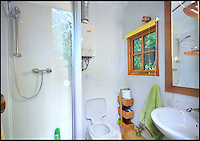 Bmth News (01202 558833)<br /> Pic QualityUnearthed/BNPS<br /> <br /> ****Must use full byline****<br /> <br /> Fully equipped bathroom.<br /> <br /> Would be Tarzan's are rushing to book up holiday's in a unique treehouse an enterprising farmer has constructed in his Devon wood.<br /> <br /> The plush &pound;200 a night treehouse might be 30ft above the ground but would be Janes will be delighted by all the mod cons including a double bed, a kitchen, a shower and a woodburning stove.<br /> <br /> And the secluded bolthole is one of only a handful of treehouses in the country which can be rented and slept in overnight.<br /> <br /> The treehouse, near Honiton in Devon, is called the Acorn Treehouse because it is nestled within the branches of an oak tree.<br /> <br /> It is rented out through letting agency Quality Unearthed for &pound;196 a night.