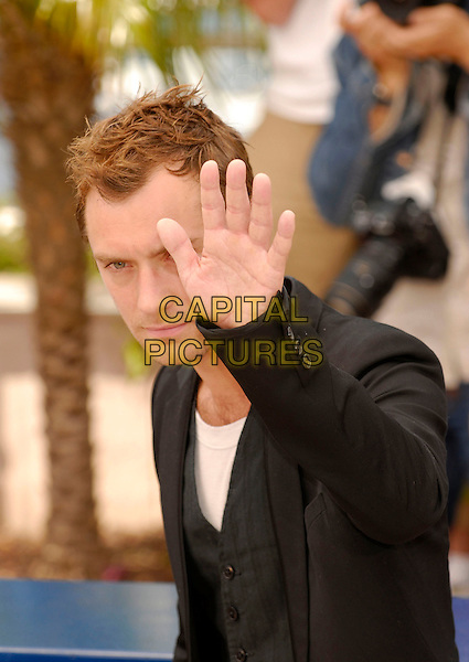 "JUDE LAW.A photocall for ""My Blueberry Nights"" during the 60th International Cannes Film Festival, Cannes, France. .May 16, 2007.half length black suit jacket waistcoat hand palm waving.CAP/KRA.©Persun/Capital Pictures"