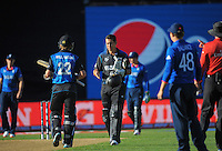 NZ's Ross Taylor shakes Kane Williamson's hand after the ICC Cricket World Cup one day pool match between the New Zealand Black Caps and England at Wellington Regional Stadium, Wellington, New Zealand on Friday, 20 February 2015. Photo: Dave Lintott / lintottphoto.co.nz