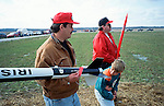 A boy checks  out  a fellow Rocketeer's rocket  at an amateur rocket festival..Manchester, Tennessee.