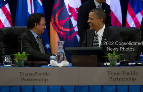 United States President Barack Obama, right, shares some thoughts with Hassanal Bolkiah, the Sultan of Brunei at the Trans-Pacific Partnership meeting at the Hale Koa Hotel in Honolulu, Hawaii on Saturday, November 12, 2011..Credit: Kent Nishimura / Pool via CNP