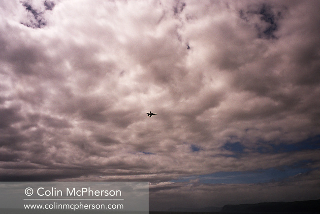 A lone jet fighter plane on a training exercise flies over the Firth of Lorne and the island of Mull on Scotland's west coast.