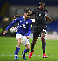 4th February 2020; Cardiff City Stadium, Cardiff, Glamorgan, Wales; English FA Cup Football, Cardiff City versus Reading; Joe Bennett of Cardiff City and Yakou Meite of Reading challenge for the ball
