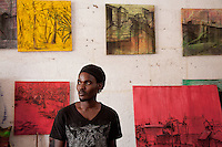 "Dickson Kaloki paints images of Nairobi's slums imbued with warm colors and a says ""these are places where people live and play."" his work challenges the stereotypes of slums as frightening places."