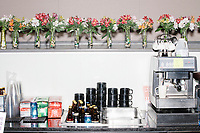 Flowers and coffee machines are seen at the bar after Democratic presidential candidate Pete Buttigieg spoke at a campaign event at the Currier Museum of Art in Manchester, New Hampshire, USA, on Fri., Apr. 5, 2019. The venue was filled to capacity about an hour before the candidate's arrival, so Buttigieg delivered an impromptu speech to those denied entry outside the museum before the official event. Buttigieg is the mayor of South Bend, Indiana, and was widely considered a long-shot candidate until his appearance in a CNN town hall in March 2019 which catapulted his campaign to prominence and substantial donations.