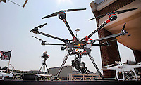 NWA Democrat-Gazette/DAVID GOTTSCHALK  A variety of Unmanned Aircraft Systems, commonly referred to as unmanned aerial vehicles or drones, on display Monday, August 31, 2015 on the terrace of Janelle Y. Hembree Aumni House on the campus in Fayetteville. The university has prohibited Unmanned Aircraft Systems on University property.