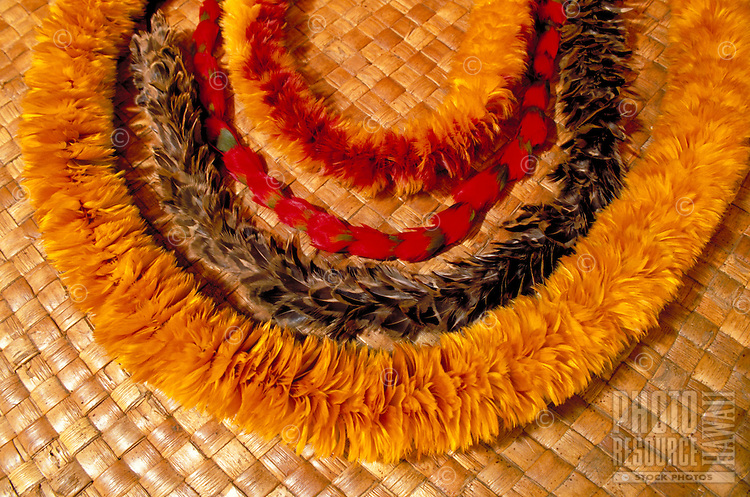 Feather leis on lauhala mat