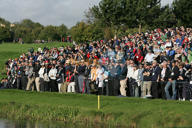 Straffin Co Kildare Ireland. K Club Ruder Cup...Thousands watch the European Ryder Cup team members Paul casey chiping onto the 6th green during the opening fourball session of the first day of the 2006 Ryder Cup, at the K Club in Straffan, Co Kildare, in the Republic of Ireland, 22 September 2006..Photo: Fran Caffrey/ Newsfile.<br />