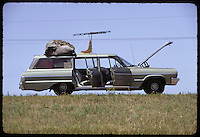 Along Route 45 South of Gann Valley, South Dakota. Hood up to cool engine at stops for Old Paints health. A 1964 Chevy Bel Air Wagon.