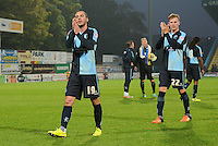 Wycombe Wanderers Michael Harriman and Jason McCarthy thank the travelling supporters following the Sky Bet League 2 match between Mansfield Town and Wycombe Wanderers at the One Call Stadium, Mansfield, England on 31 October 2015. Photo by Garry Griffiths.